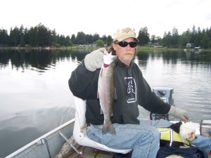 """UNCLE WES"" WITH A BEEFY RAINBOW CAUGHT OUT OF WESTERN WASHINGTON'S LAWRENCE LAKE YESTERDAY. (BRETT MALMBER)"
