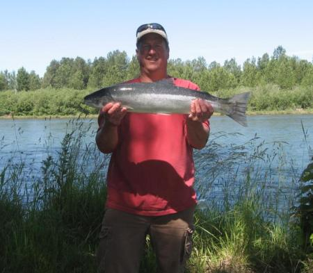 DAVID RASH WITH A JUNE 25 COWLITZ RIVER STEELHEAD. (LAZER SHARP PHOTO CONTEST)