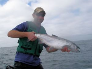 THE BLOGGER WITH A 13- OR 14-POUND CR BUOY COHO. (ANDY SCHNEIDER)