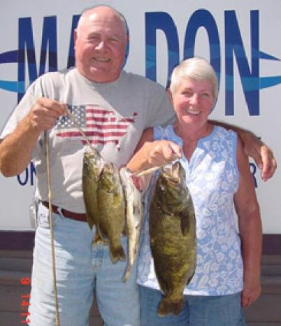 NIC AND MILLIE NICHOLS' SECRET SPOT GAVE UP SMALLIES TO 4 POUNDS, 10 OUNCES ON A NORTHLAND JIG TIPPED WITH A WORM. (MAR DON RESORT)