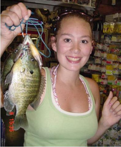 ALLISON BAILEY OF PUYALLUP, WASH., SHOWS OFF A MAR DON DOCK BLUEGILL, CAUGHT ON RED WORMS. (MAR DON RESORT)