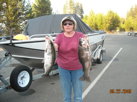 CHRISTINE MARSHALL OF EUGENE DISPLAYS A PAIR OF FAT DIAMOND LAKE RAINBOWS. (DIAMOND LAKE RESORT)
