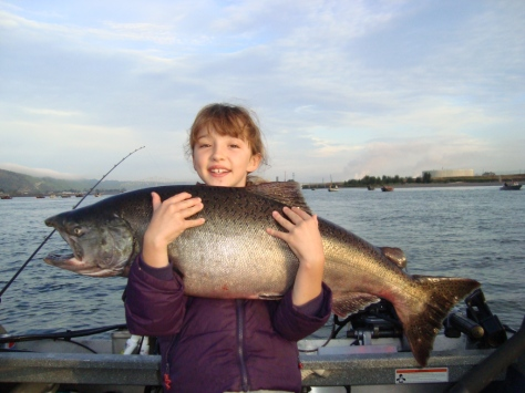 MADELYNN OLSON, 9, AND HER 25-POUNDER. (LAZER SHARP PHOTO CONTEST)
