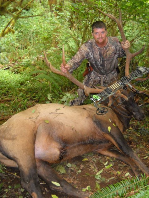 TED SPENCER JOINS OREGON'S BIG-COAST-BULL-KILLIN' CLUB IN HIS FIRST SEASON WITH A BULL. (HI-VIZ PHOTO CONTEST)