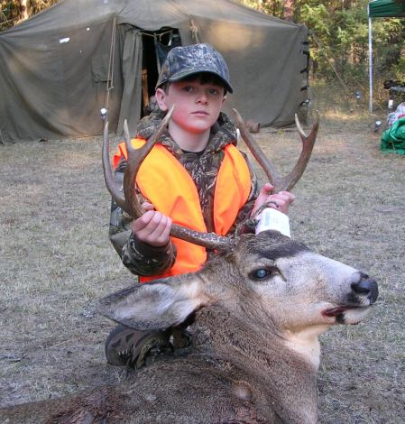 DYLAN KOHLER'S FIRST DEER, TAKEN LAST FALL NEAR REPUBLIC. (HI-VIZ PHOTO CONTEST)