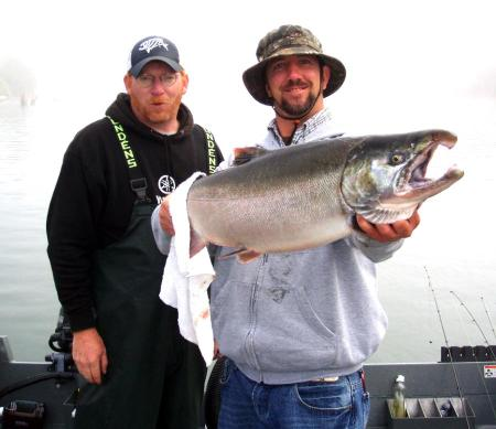 JON PULLING'S 14-13 COHO, CAUGHT WITH GUIDE JIM STAHL. (LAZER SHARP PHOTO CONTEST)